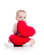 baby girl with pillow in heart shape