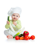 kid boy wearing a chef hat with healthy  food vegetables