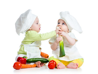 children boy and girl wearing a chef hat with healthy  food vege