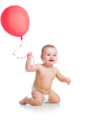 Smiling baby boy  with red  ballon in his hand isolated on white