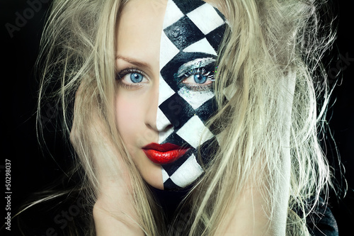 Closeup of woman with chess pattern on face