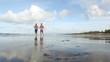 Healthy pair running  on a coastline
