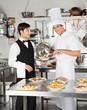Chef Giving Pasta Dish To Waiter