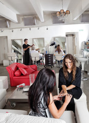 Woman Having Manicure At Parlor