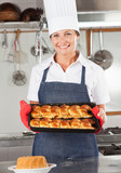 Female Chef Holding Baked Bread