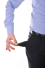 Young business man pulling out empty pocket.