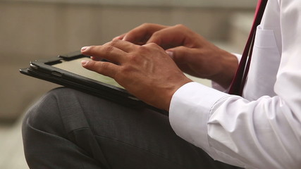 Businessman hands typing on a laptop