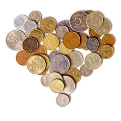 Coins are in the shape of a heart on a white background