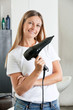 Hairstylist With hair Dryer At Salon