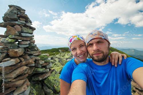 Portrait of couple at the top of the mountain