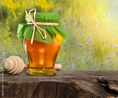 Honey jar on the wooden table