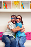 couple in 3d glasses watching movie