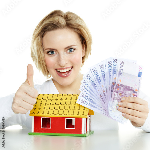 Woman has enough money for a house, shows thumb up