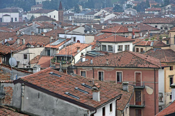 red tile rooftops and houses in an old Italian town