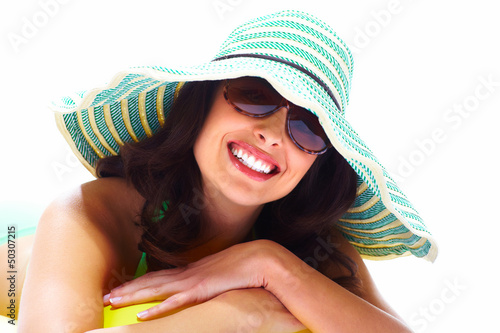 Woman relaxing on the beach.