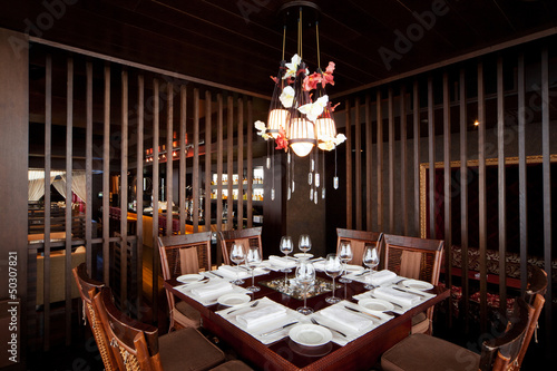 banquet table in a restaurant with a brown wooden interior