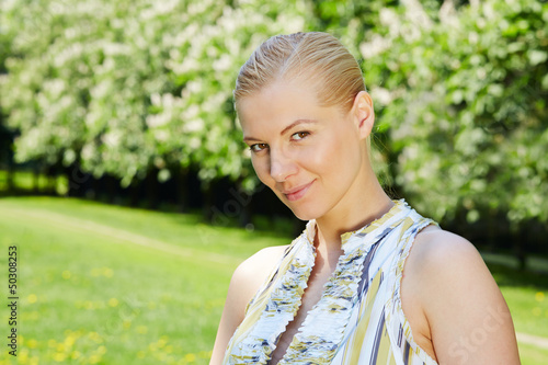 Portrait of girl in spring blossoming park