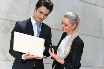Business couple reviewing data.