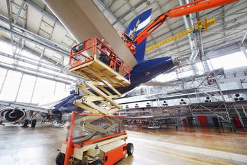 Repair of plane aircraft in hangar