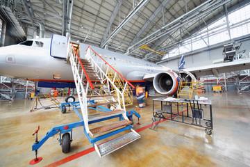 Repairing plane in hangar