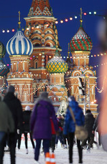 People skate on Red Square near to Saint Basil Cathedral, Moscow