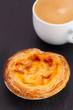 pastel de nata with cup of coffee