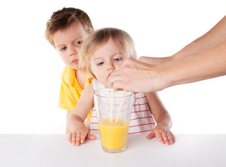 Children watch as pouring juice isolated on white