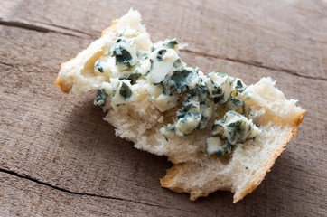 Roquefort spread on a slice of bread.