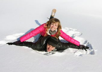 Young loving couple on  a snow