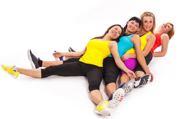 Group of women relaxes after exercises