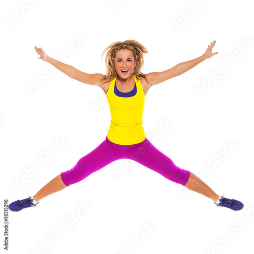 Beautiful woman in fitness wear jumping