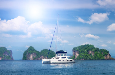 white beautiful yacht against rocks. Thailand