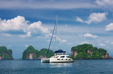 white catamaran to stand against rocks. Thailand