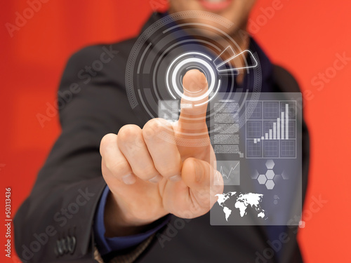 handsome man in suit pressing virtual button