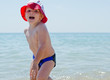 Cute little boy romping in the sea