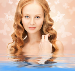 beautiful woman with butterflies in water