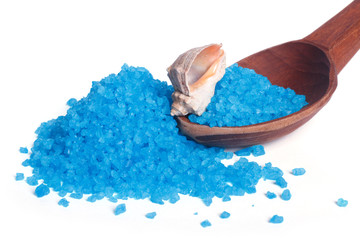fragrant blue bath salt and sea shell on a wooden spoon