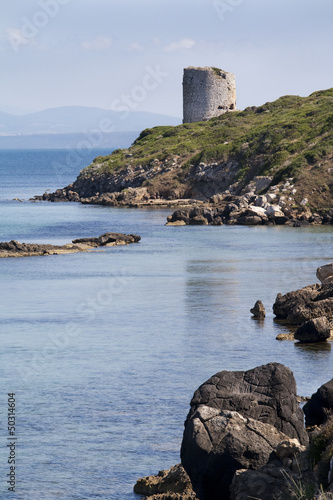 Marina Tower and rocks on sea and blue sky