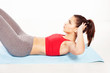 Fit young woman practicing abdominal exercises