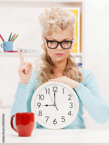 businesswoman with clock and finger up