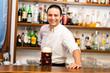 Bartender in his bar