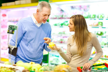Woman and man shopping in a supermarket