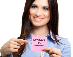 Businesswoman showing the words Contact Us