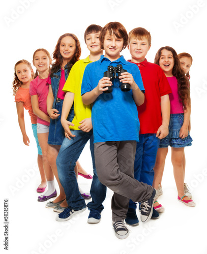 Nice boy with binoculars in a group