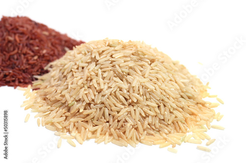 Pile of red and brown rice on white background