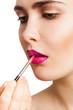 Applying lipstick brush