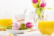 Leinwandbild Motiv Gedeckter Osterfrühstückstisch