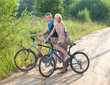 The guy and the girl by bicycles on the rural road