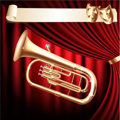 Classical baritone horn / Euphonium tuba on a red velvet curtain