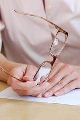 Female hands holding eye glasses